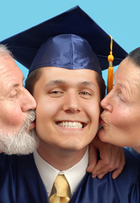 graduate with parents kissing him