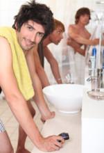 boys in college dorm bathroom