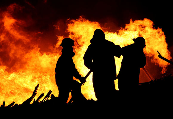 firemen fighting structure fire