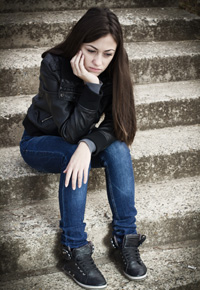 lonely girl sitting on steps